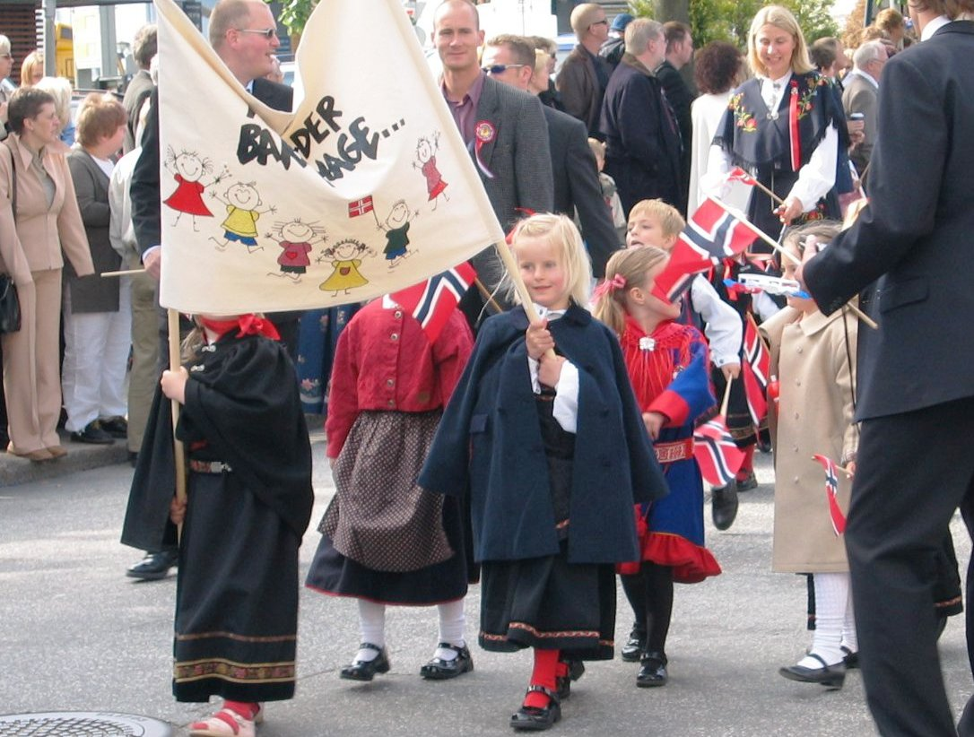 Children in national dress walking in a parade. Norway's constitution day.